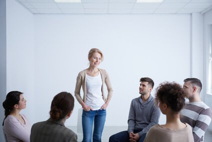 Woman talking about her life during group therapy